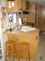 30'Fleetwood travel trailer with queen bed and bunks