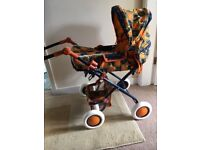 Toy pram, collapsible, pristine condition, with matching bag and removable carry cot. Smoke free.