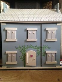 Pretty wooden dolls house with accessories