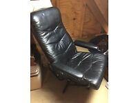 Black leather swivel reclining chair