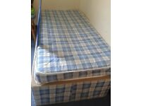 Single bed base and mattress with storage.