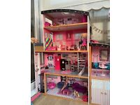 Barbie town house with loads of accessories
