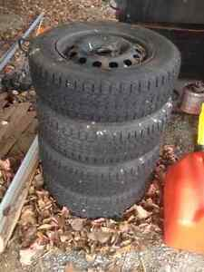 snow tires on rims 4 & 100 Belleville Belleville Area image 1