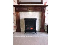 Marble Hearth and back drop. Wooden mantle piece mirror and electric fire