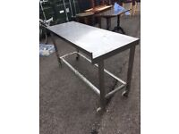 Large stainless steel table on locking wheels heavy and solid.