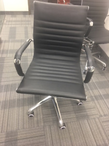 Brand new genuine leather and steel swivel chair