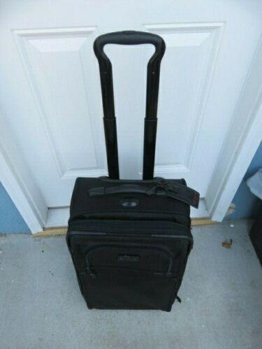 Used Tumi alpha 22020dh international expandable black nylon wheeled carryon bag