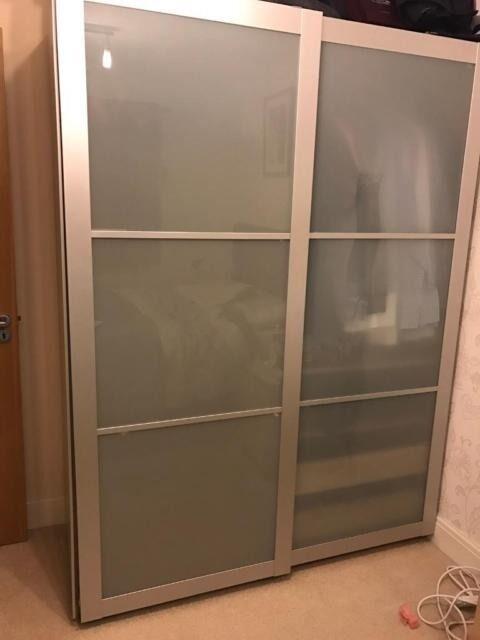 ikea pax wardrobe with sliding opaque grey sekken doors. Black Bedroom Furniture Sets. Home Design Ideas