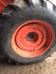16.9 x 30 Firestone tractor tires  being removed off my tractor