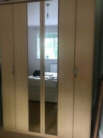 Wardrobe with 3 bi fold doors and a centre mirror