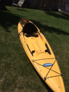 Sit on top 11 foot  kayak complete with paddle.