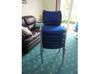 6 BLUE STACKING CHAIRS