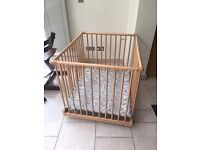 Solid Wooden Foldable Height-Adjustable Playpen on wheels in very good condition