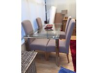 Glass Table and 4 fabric chairs