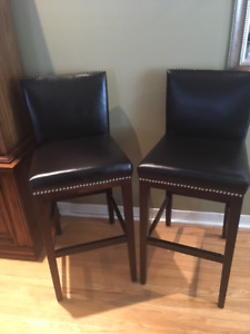 2 black leather high chairs/bar chairs