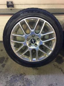 4 pneu hiver 215/55/r18 et mag de mustang