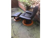 Swivel reclining leather effect brown armchair with matching footstool - modern design, 3 years old
