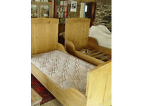Two antique pine Dutch cabin-style beds