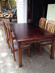 "Dark brown 64 / 84"" dining room table and 4 chairs"