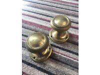 Pair of brass door knobs