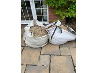 Gravel in two builders bags