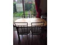 Solid wood extendable diner table + 4 chairs