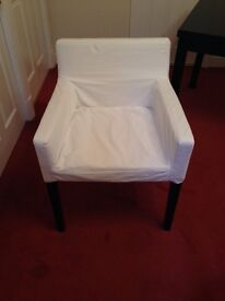 Ikea extending table and 4 chairs with white/cream covers.