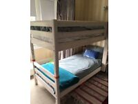 White wooden bunk beds for sale.