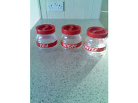 Glass kitchen caddies set, clear glass with red trim/lids