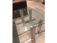 Beautiful Glass Nest of Two Tables with Rolling Feature