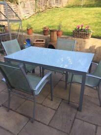 Garden Glass and metal garden table and 4 chairs. Buyer collects