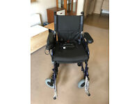 Electric wheelchair, excellent condition, hardley used, never used outside.