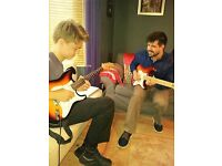 Free Trial Lesson. Guitar Lessons with A Professional Guitar Tutor / Guitar Teacher