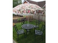 ROUND METAL GARDEN TABLE WITH 4 CHAIRS AND UMBRELLA AND 4 SEAT CUSHIONS