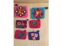 Handmade felt coin purses with floral patterns