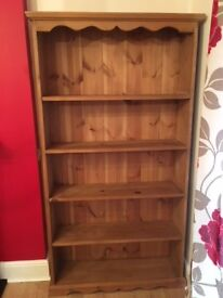 Solid aged pine bookshelf, excellent condition. Sale due to downsizing house move