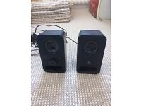Pair of small black Logitech speakers