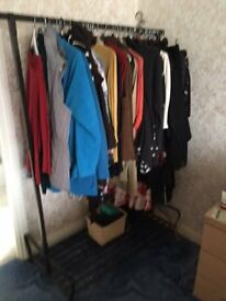Free standing clothes rail with lower storage shelf