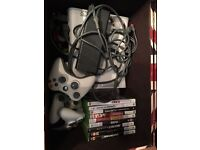 White Xbox 360 with 3 controllers and 9 games