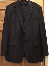 Men's dress suit in charcoal grey. Jacket size 48L. Trousers 42L.