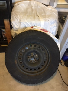 Used Winter Tires: Blizzak P245/65R17  on rims