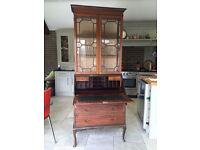Antique edwardian mahogany writing desk with book shelf on top.
