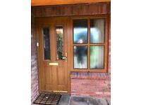 Composite door and window in golden oak