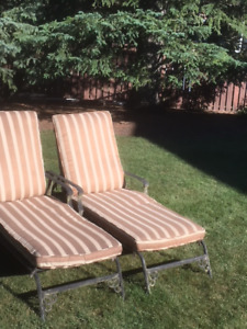 Two Wrought Iron Chaise Lounge Patio Chairs with Cushions