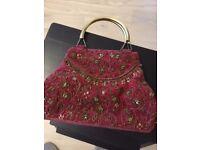 Red velvet evening bag with metal handles