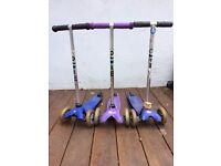 Three used mini micro scooters, blue and purple