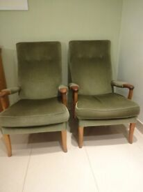 two plain green material parker knoll armchairs