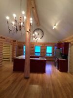 Executive Log Home on secluded 10 acres