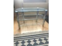 Glass 32 inch TV stand, corner unit with three shelves.