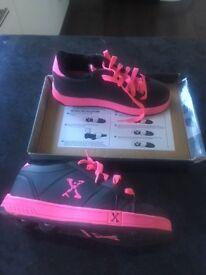 Sidewalk sports wheeled shoes size 4